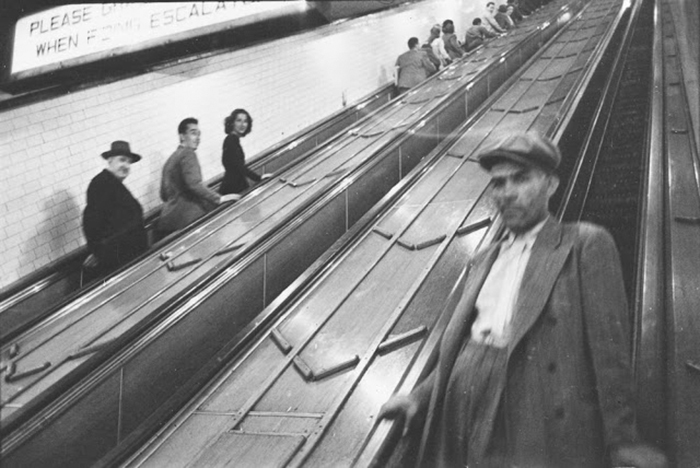 People on escalators in a subway station, 1940