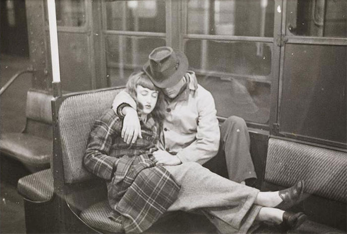 Couple sleeping in a subway car, 1940s
